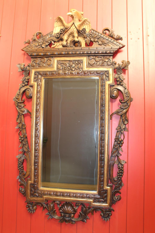 Decorative walnut and gilt wall mirror