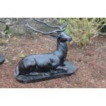 Cast iron model of a seated Stag.