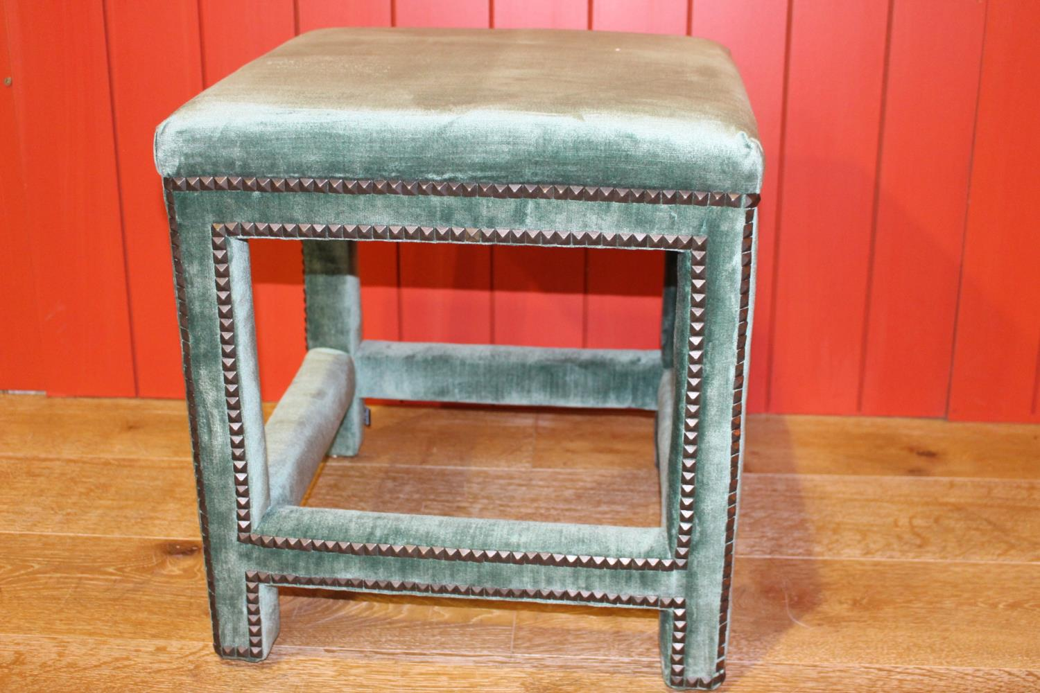 Upholstered low stool.