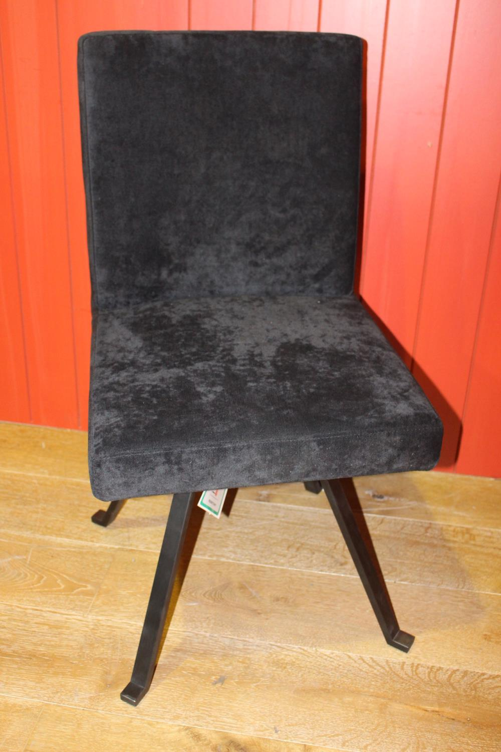 Black velvet upholstered swivel chair