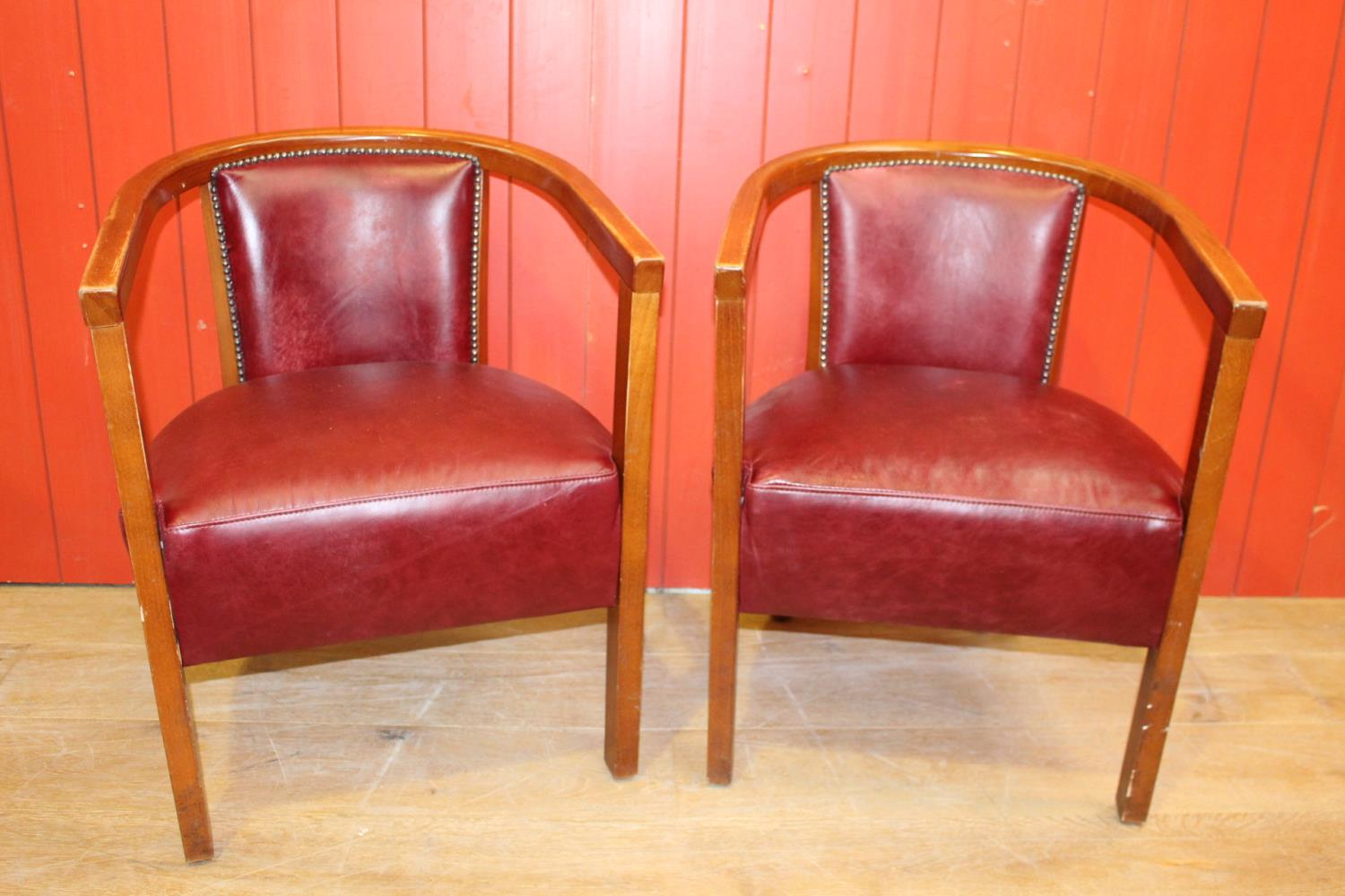 Pair of leather tub chairs.
