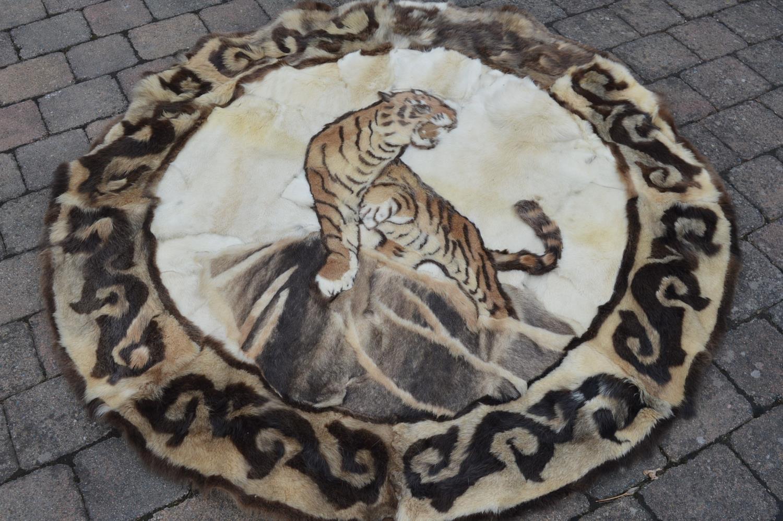 Cicular animal skin carpet.