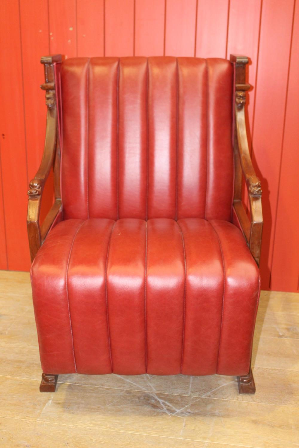 Leather upholstered open armchair