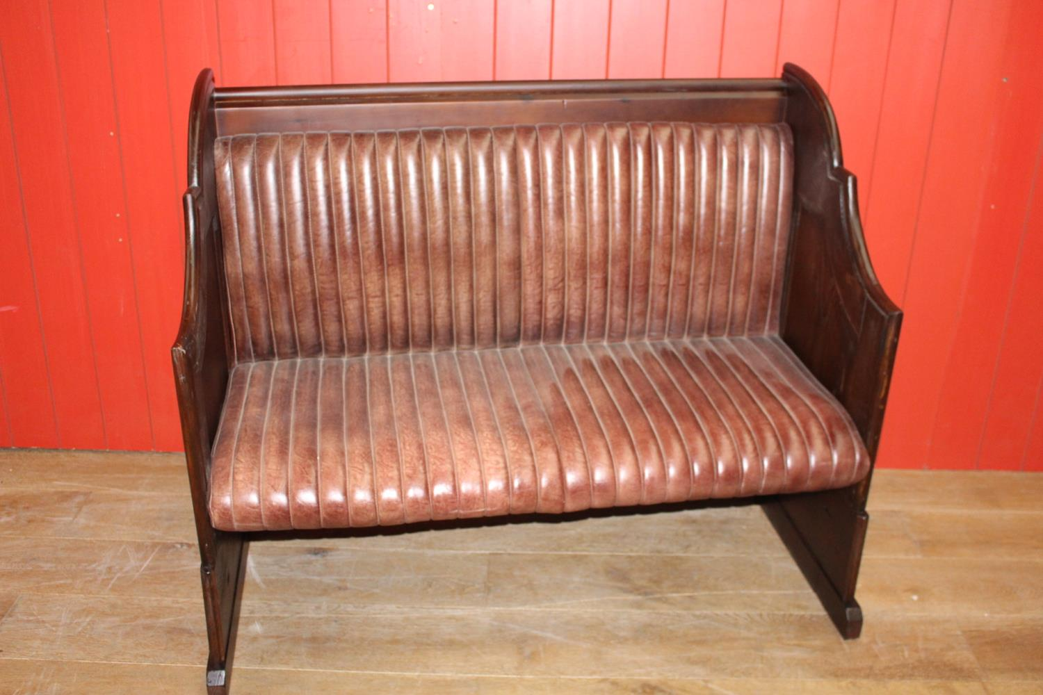 Leather upholstered wooden bench
