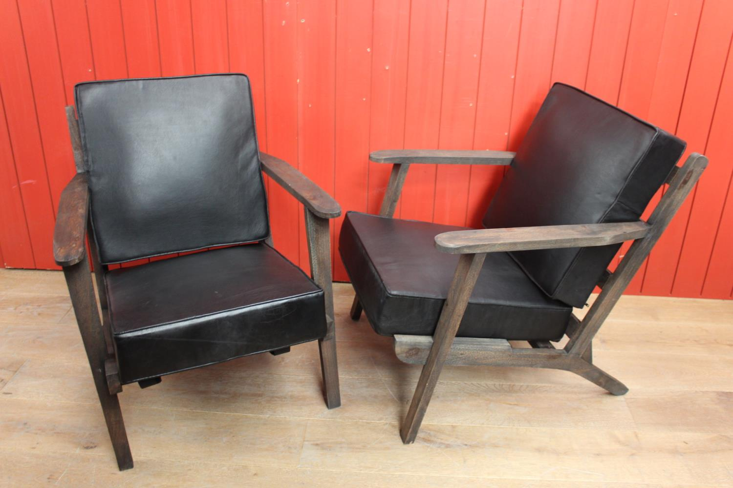 Pair of wooden and leather upholstered easy chairs