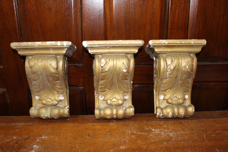 Three plaster corbels