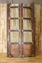 Pair of oak doors with brass mounts