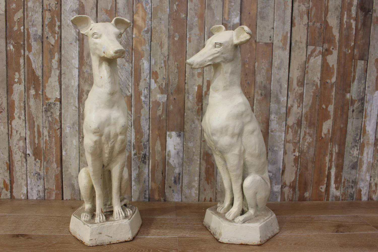 Pair of cast iron models of whippet dogs