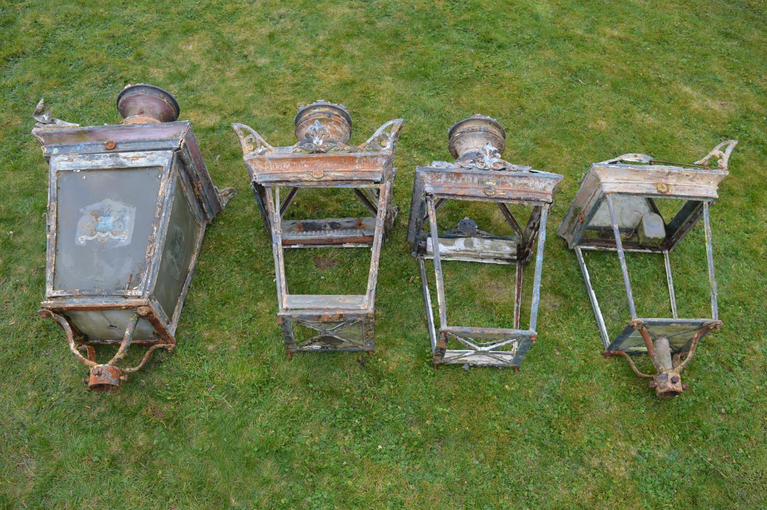 Set of four wrought iron and copper lanterns.