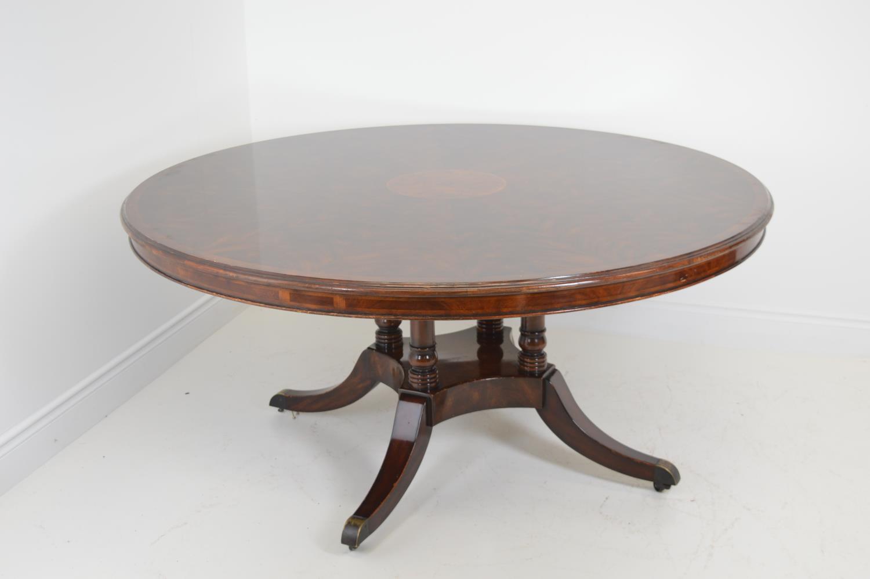 Mahogany circular dining table.