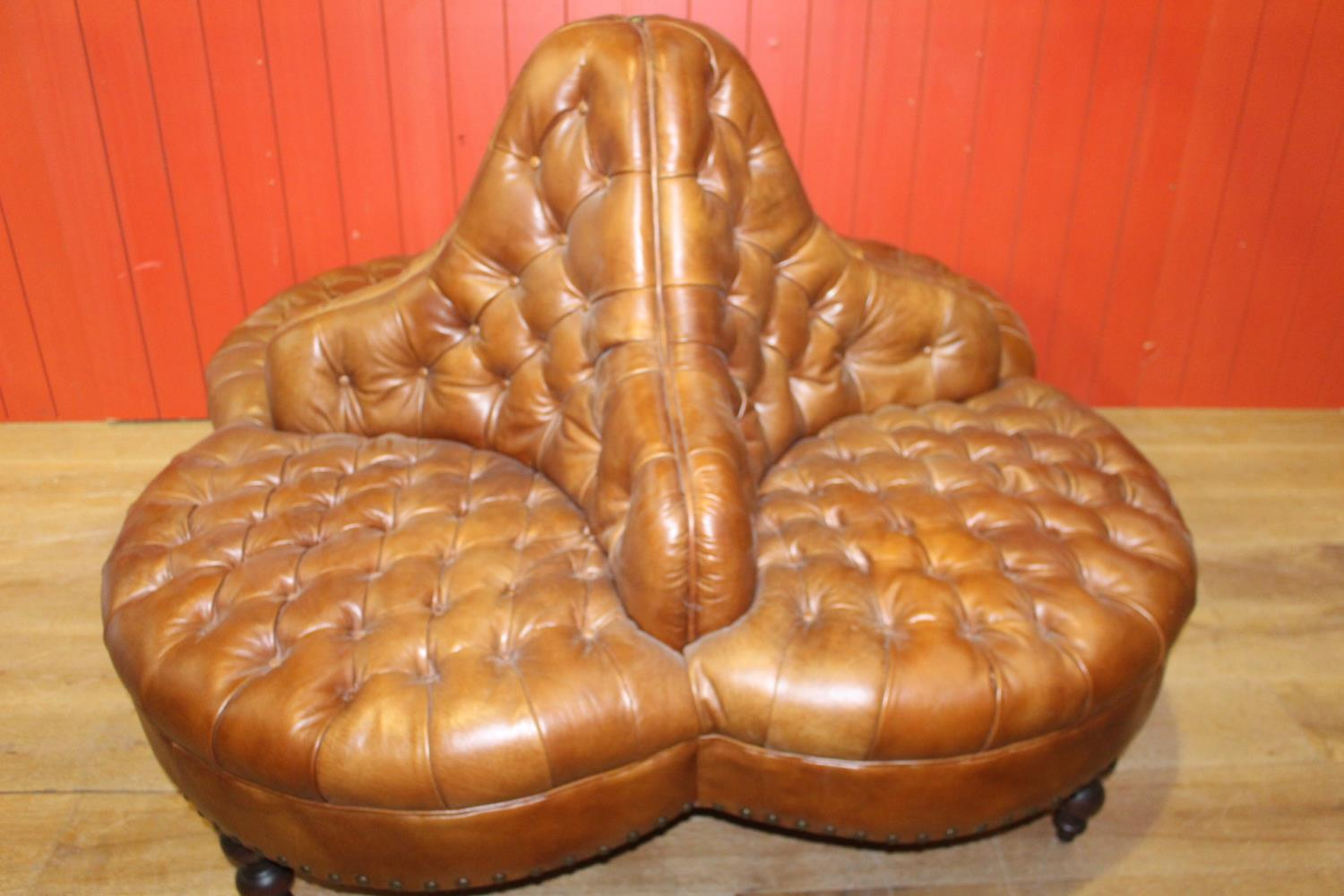 Leather upholstered conversation seat.
