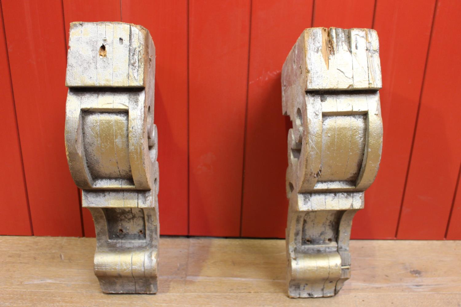 Pair of carved wooden corbels