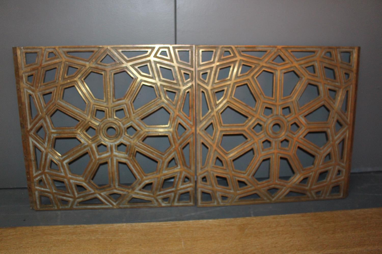Brass floor/ceiling hinged panels