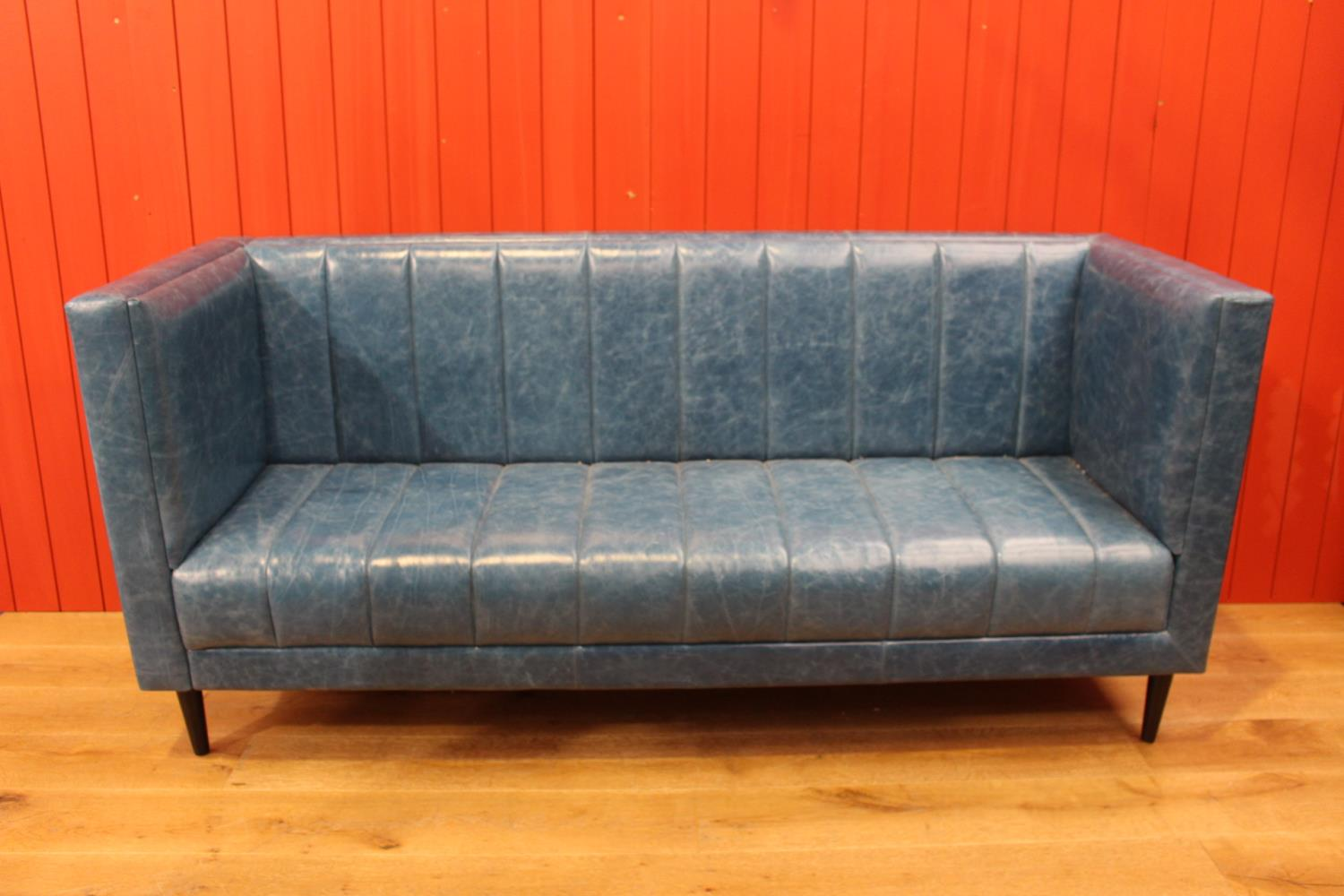 Leather upholstered three seater settee