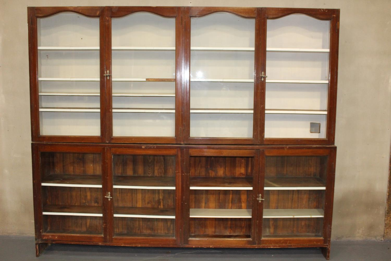 19th C. Mahogany two piece shop display cabinet