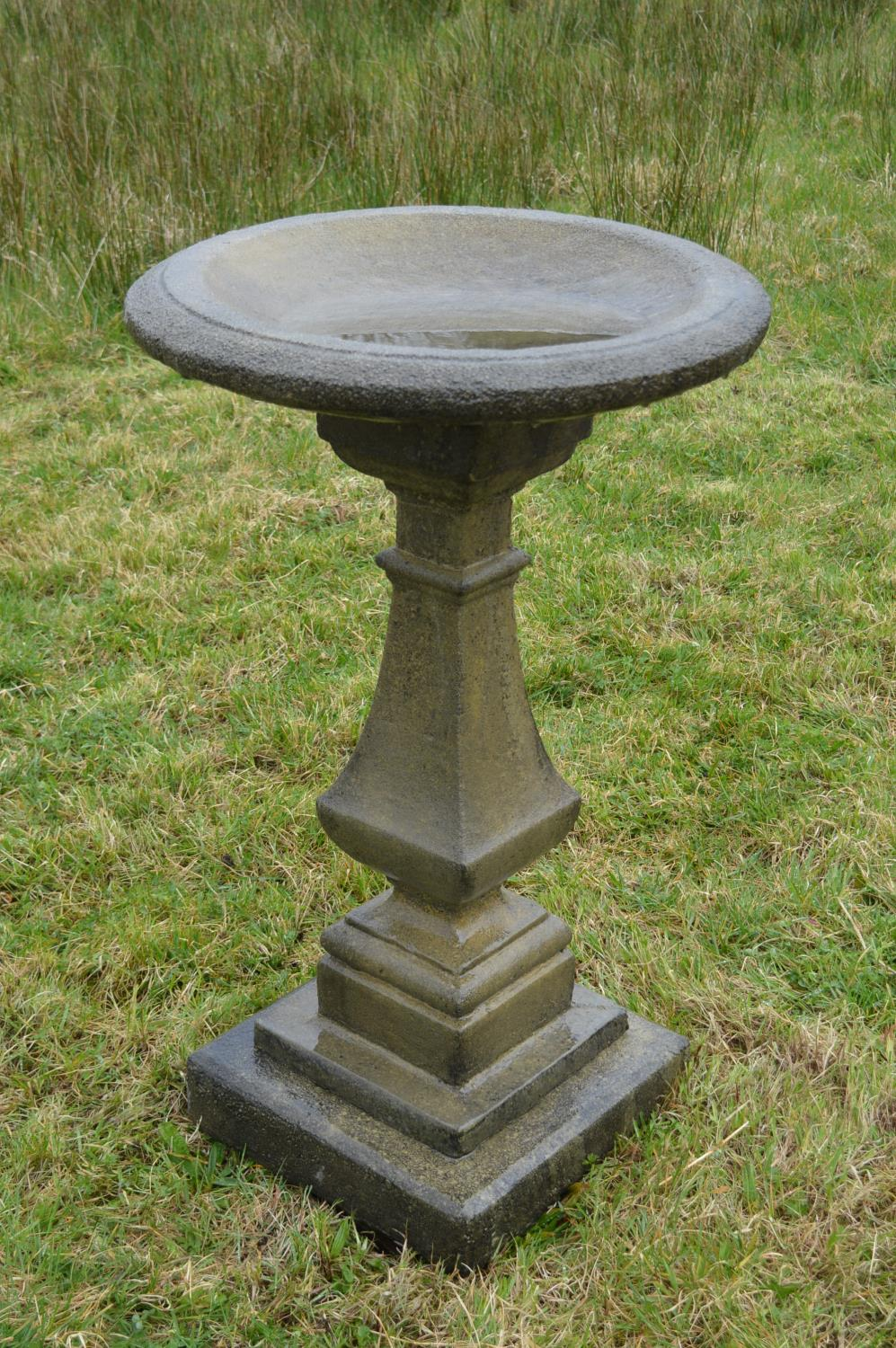 Composition bird bath in the Victorian style.