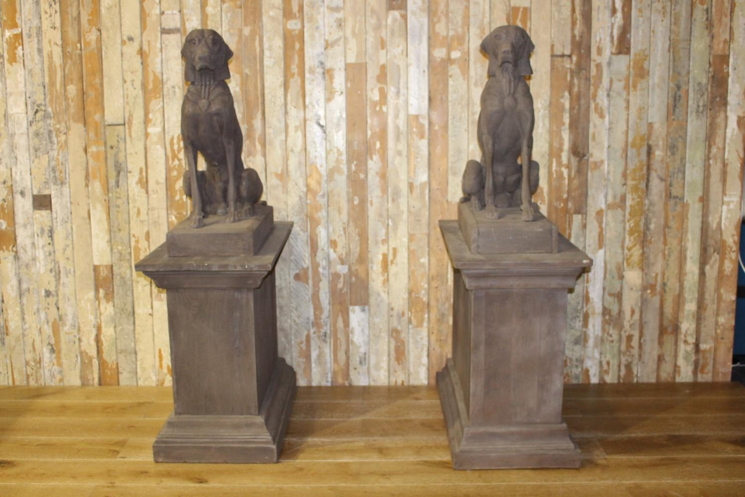 Pair of models of seated Hounds