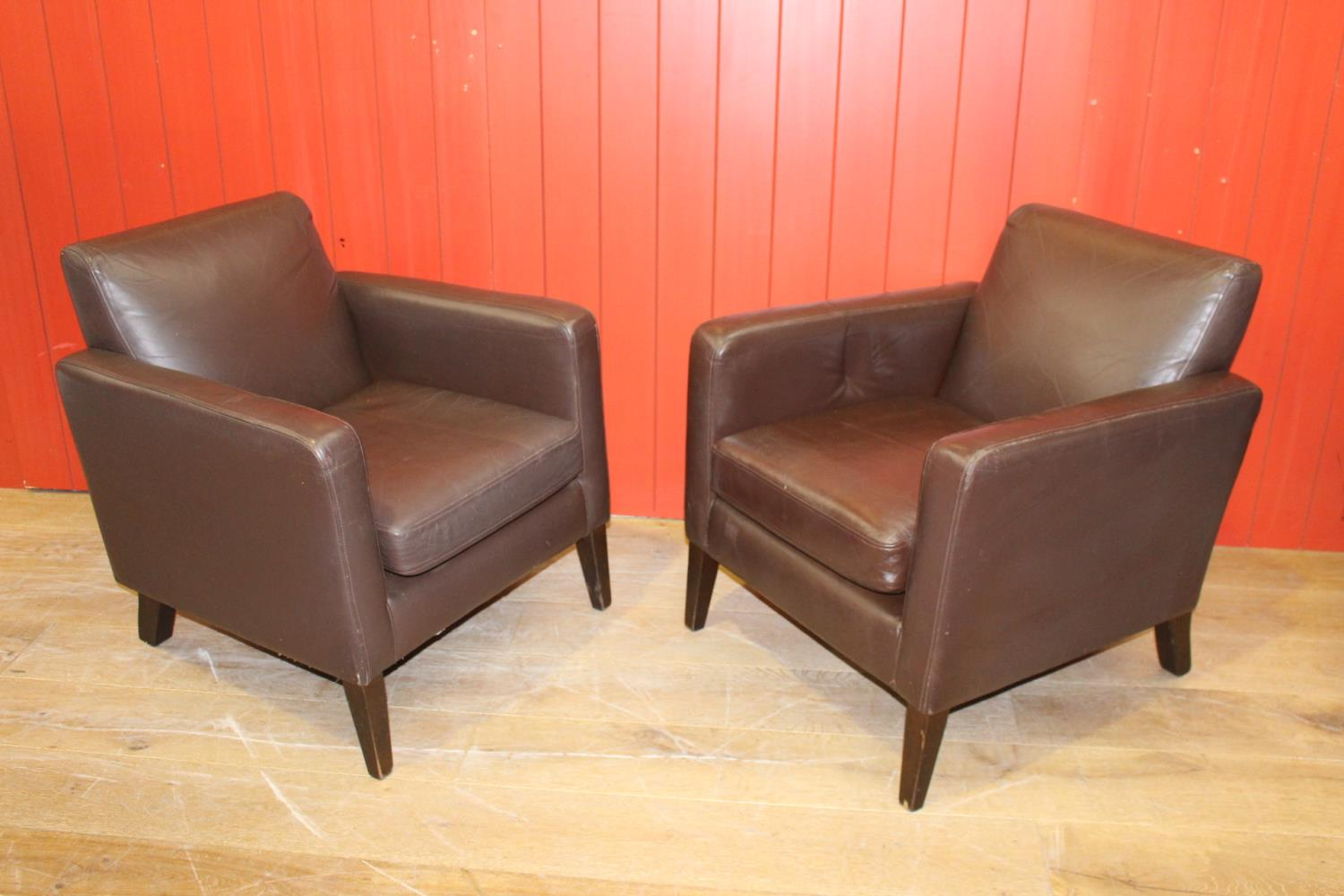 Pair of leather upholstered retro style armchairs