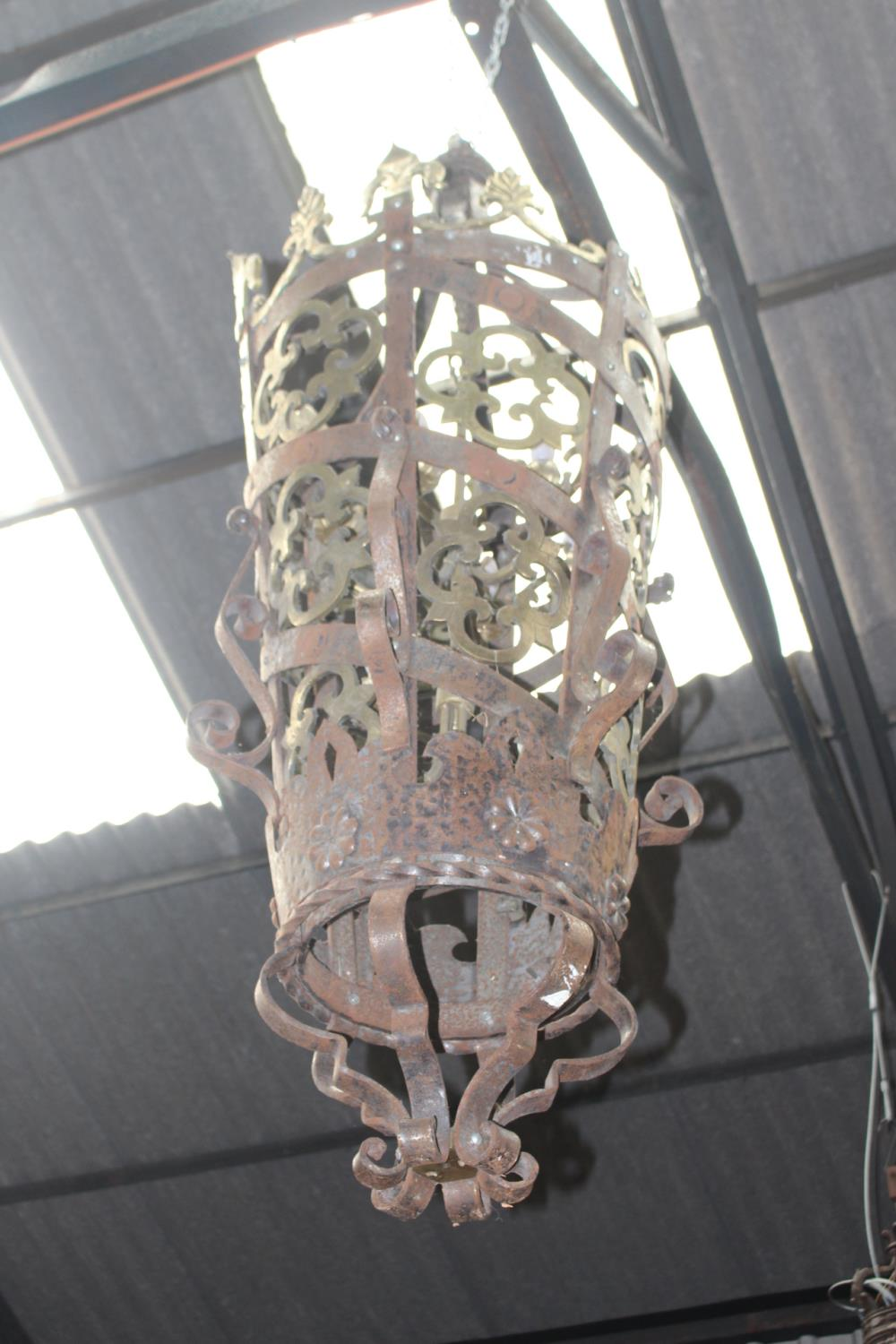 Good quality brass and wrought iron lantern in the Gothic manner {170 cm H x 40 cm Dia.}.