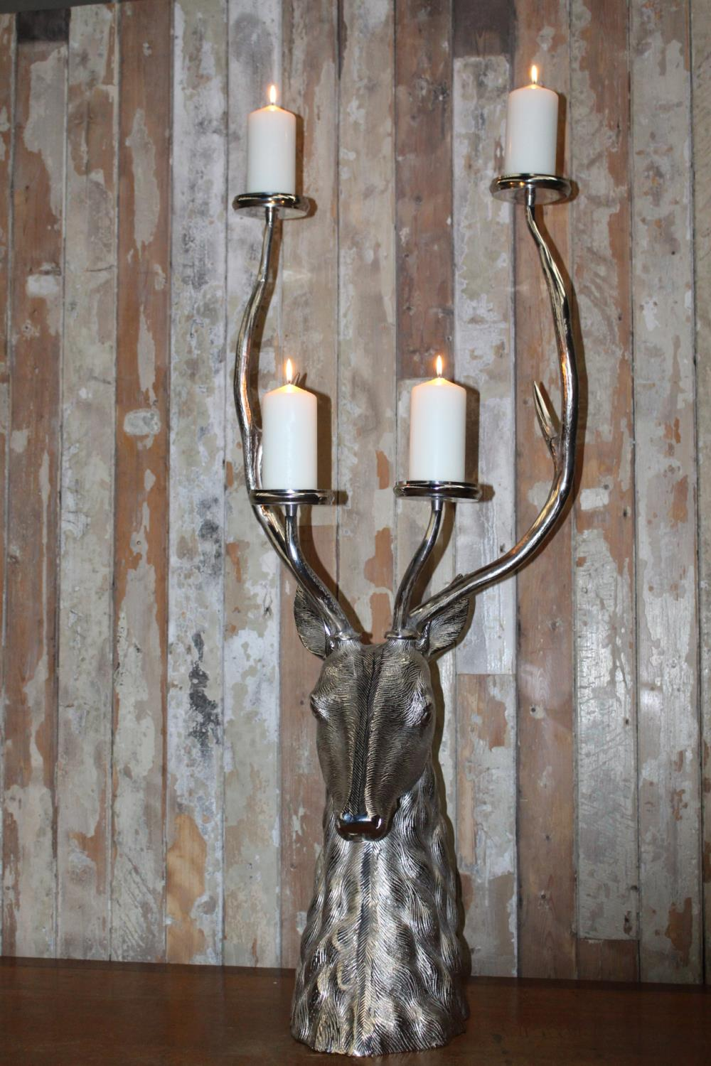 White metal four branch candle holder