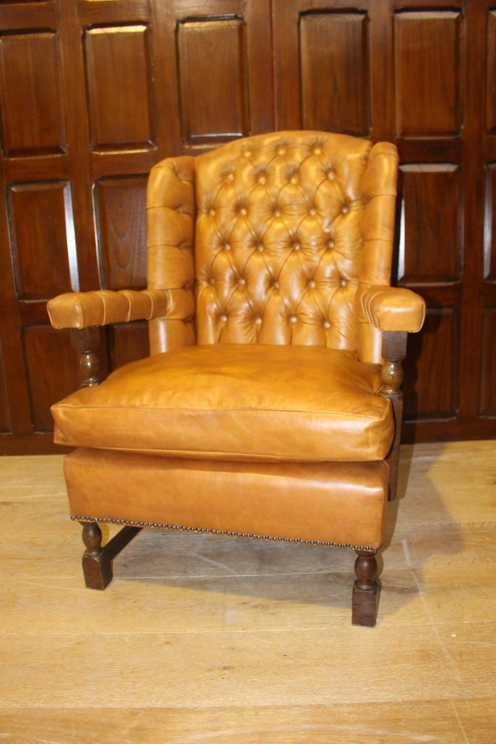 Leather wingback open armchair.