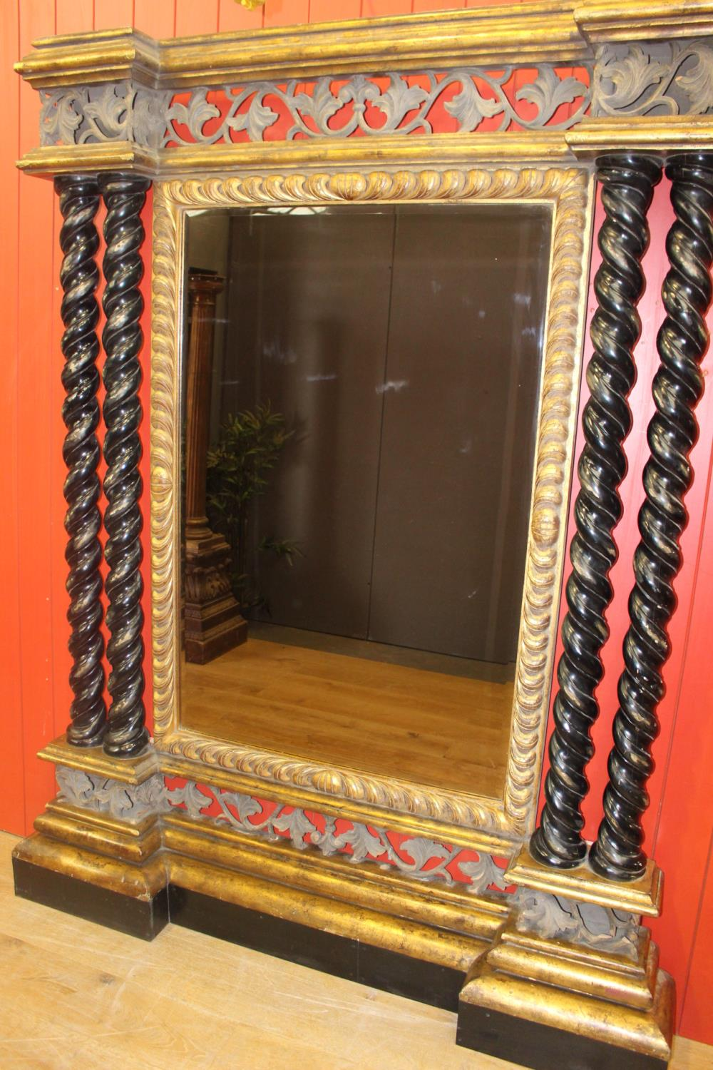 Decorative giltwood and ebonised wall mirror