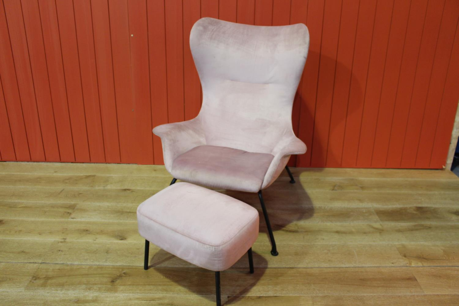 Fabric upholstered and metal framed armchair
