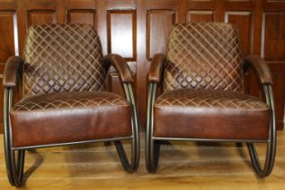 Pair of leather upholstered metal armchairs