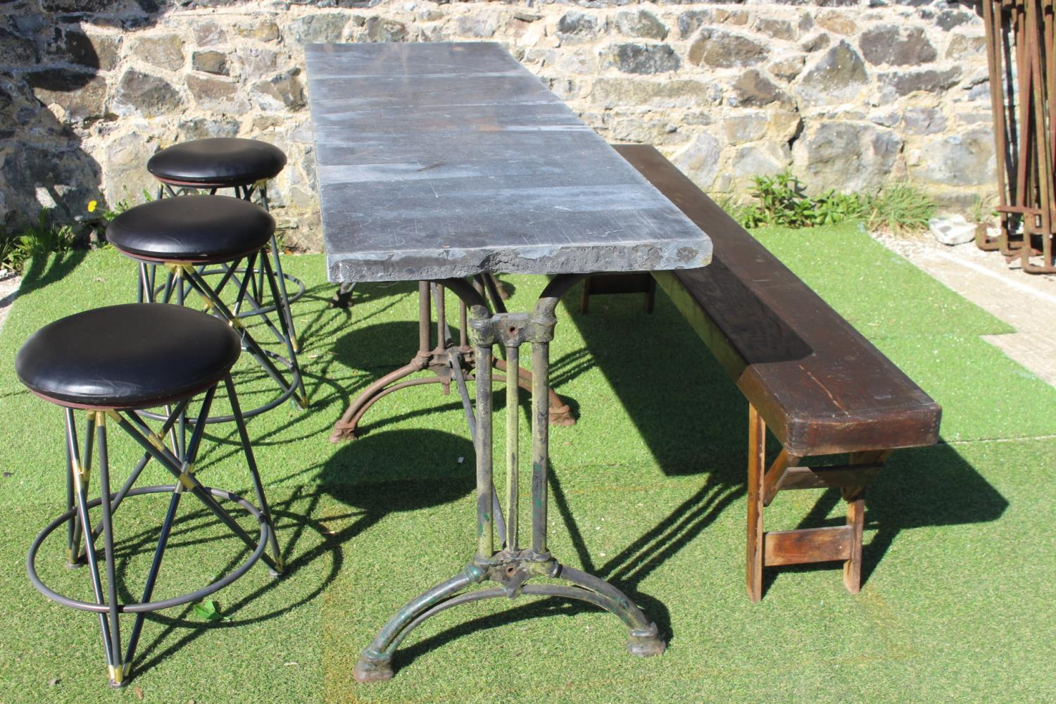 Cast iron table with marble top, bench and stools
