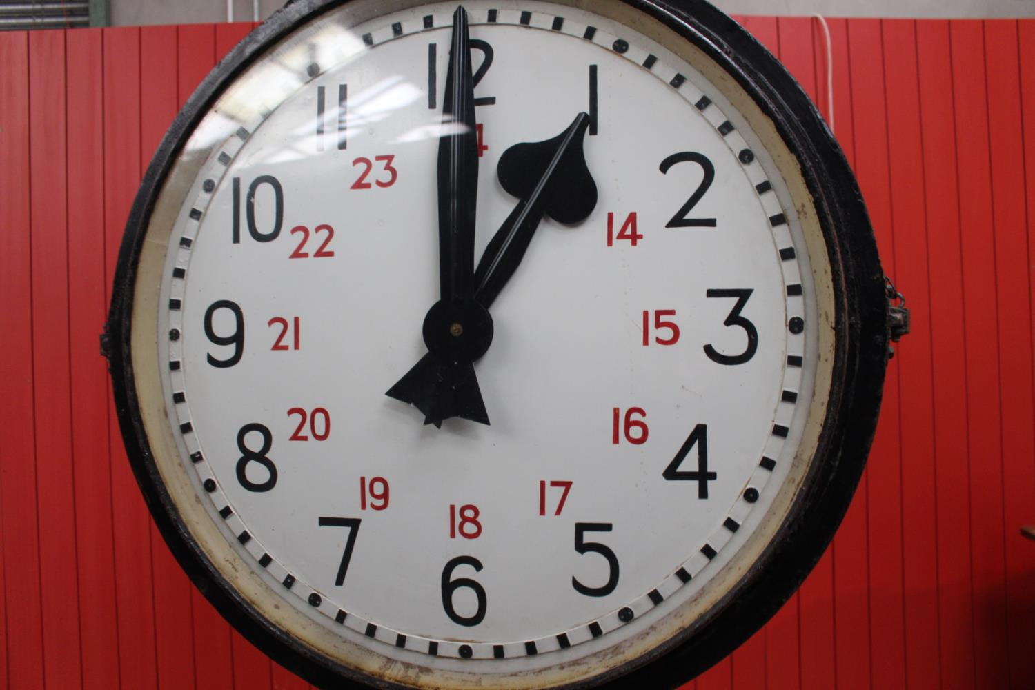Metal doubled sided Station clock.
