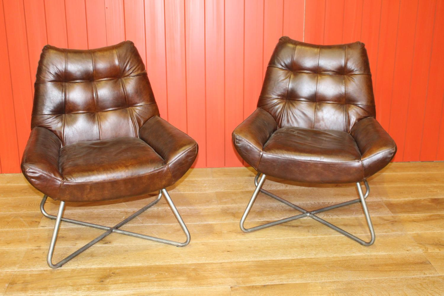 Pair of leather upholstered deep buttoned back chairs