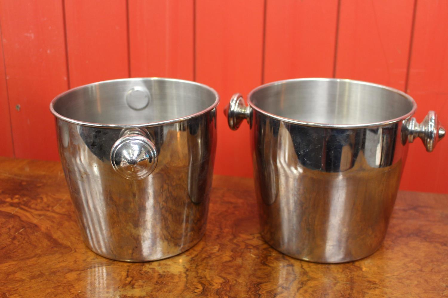 Pair of white metal champagne buckets