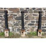 Set of three cast iron bollards