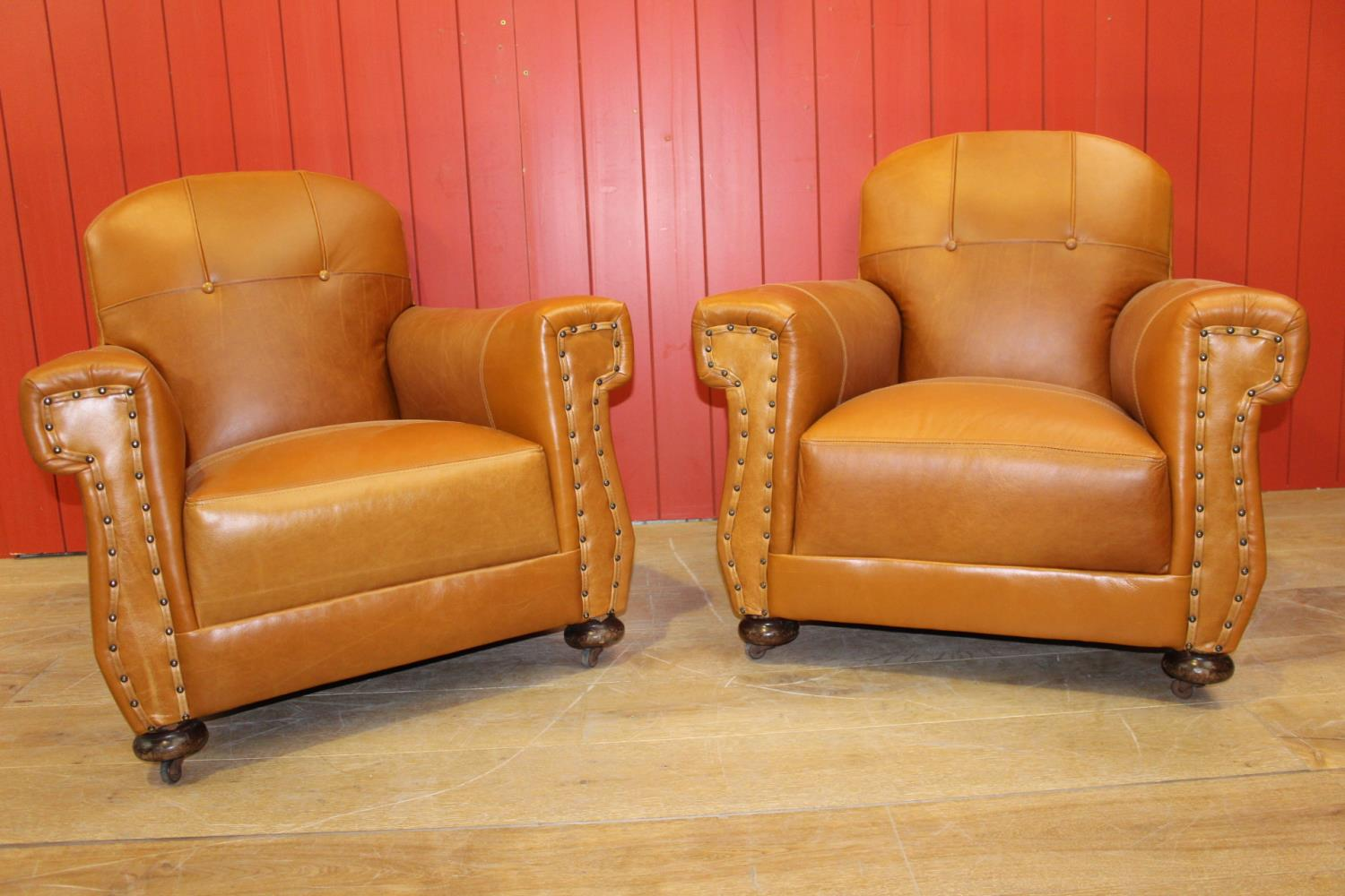 Pair of leather upholstered club chairs.