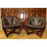Pair of leather and wooden bucket chairs