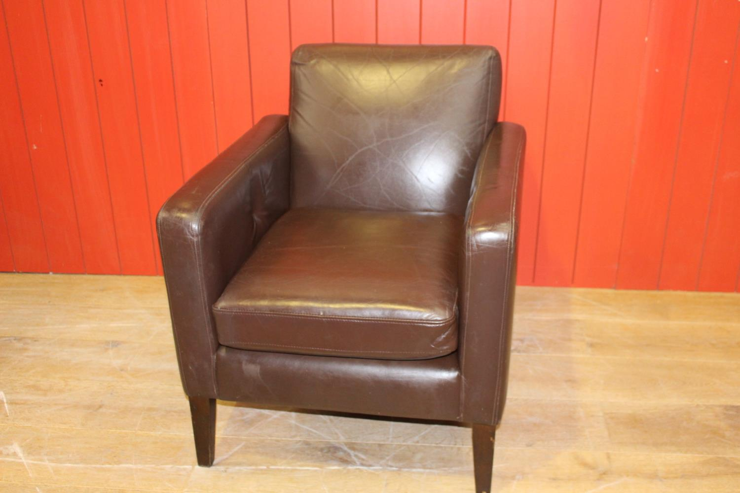 Single leather upholstered retro style armchair.