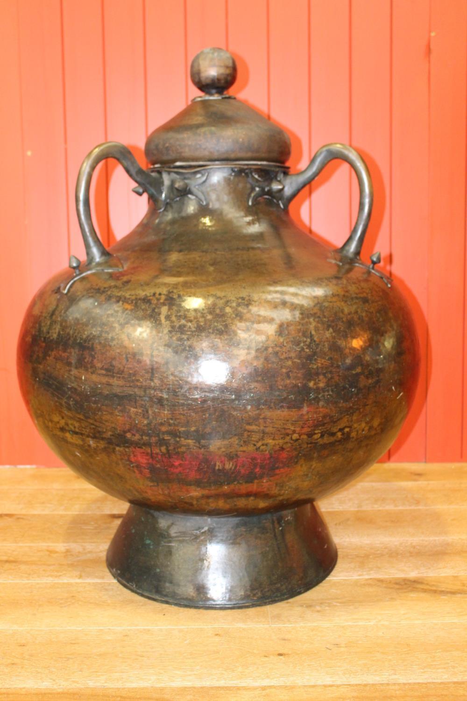 Three handled urn.