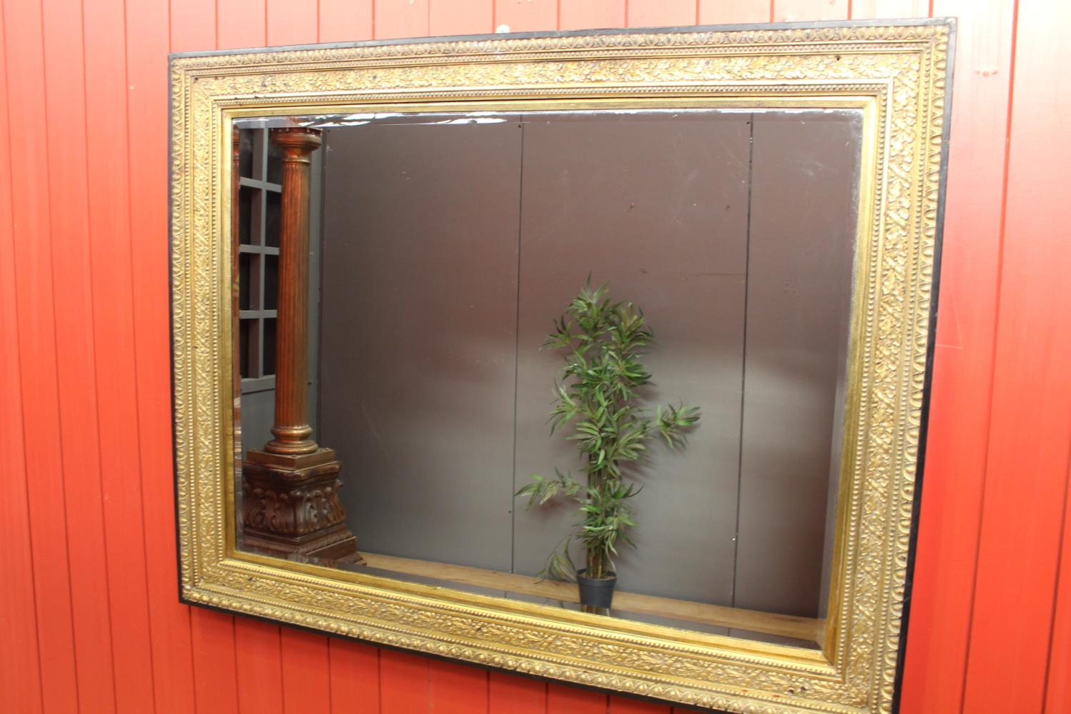 Ebonised and giltwood wall mirror