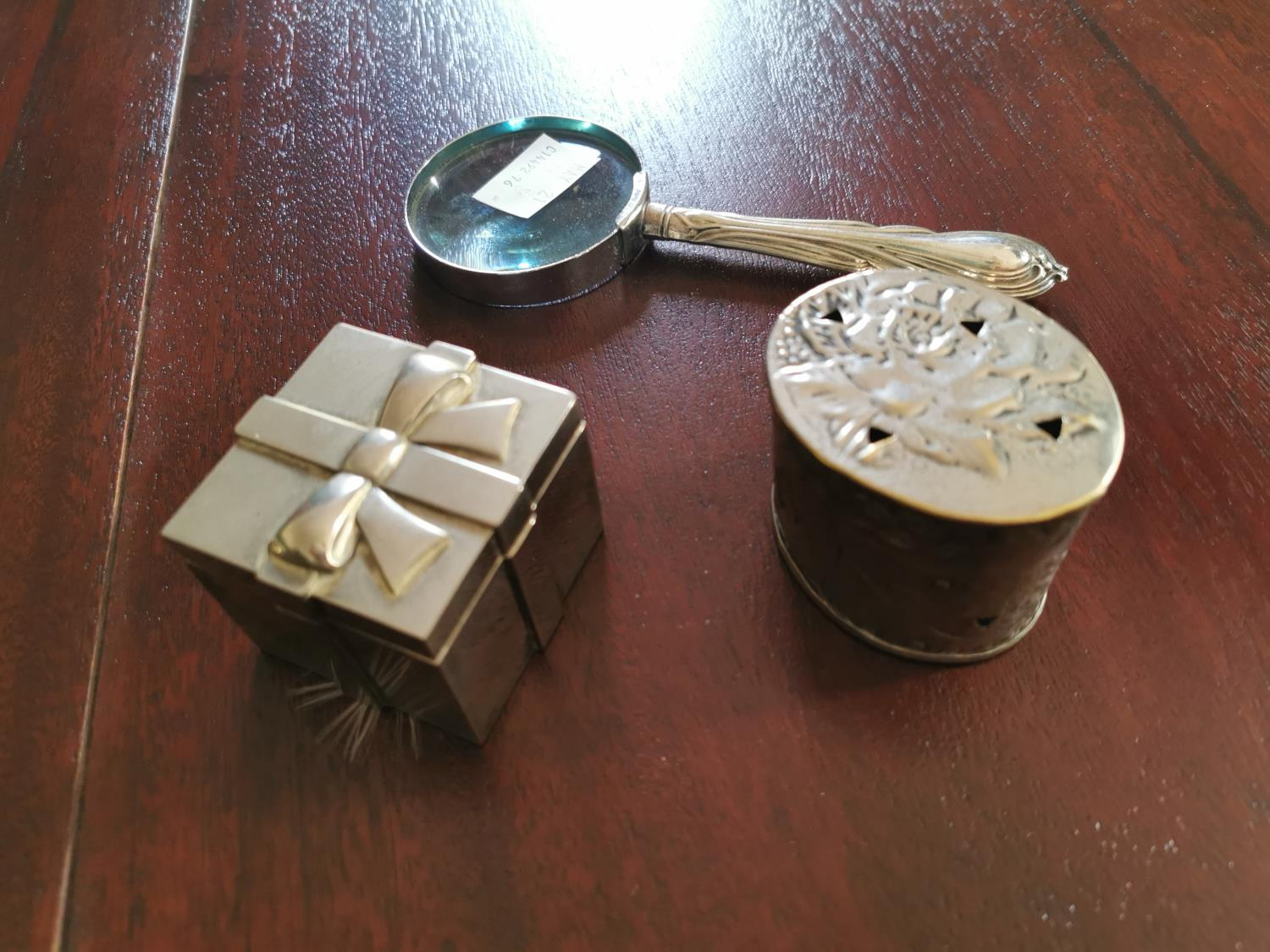 Silverplated scent box , inkwell and magnifying glass