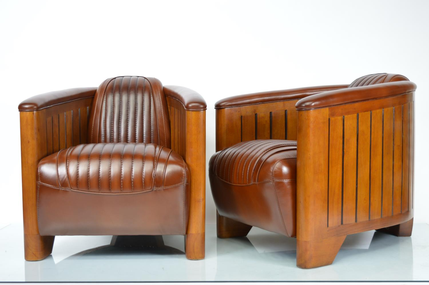Pair of leather and walnut Aviator style chairs