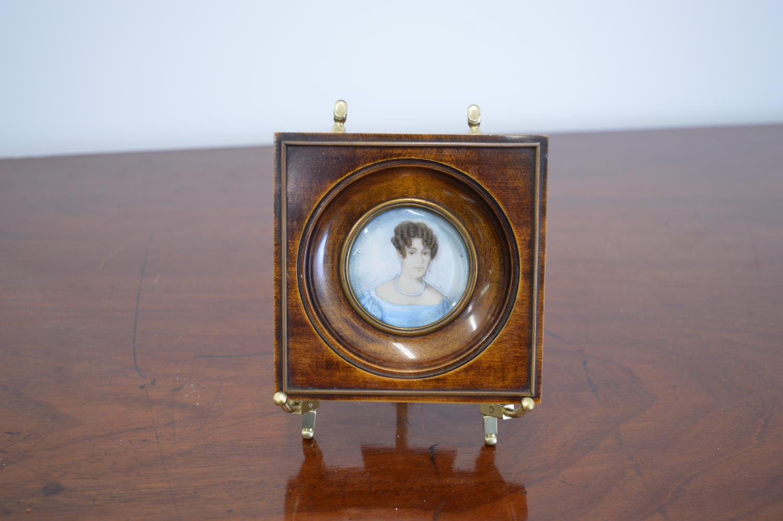 Miniature portrait of Lady mounted in walnut frame. {11 cm H x 11 cm W}.