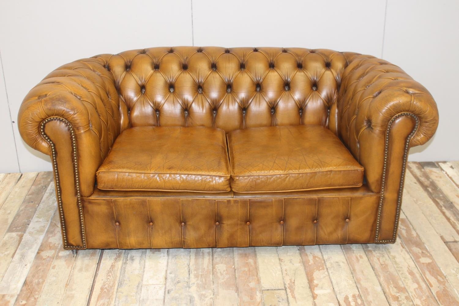 Leather upholstered two seater Chesterfield sofa