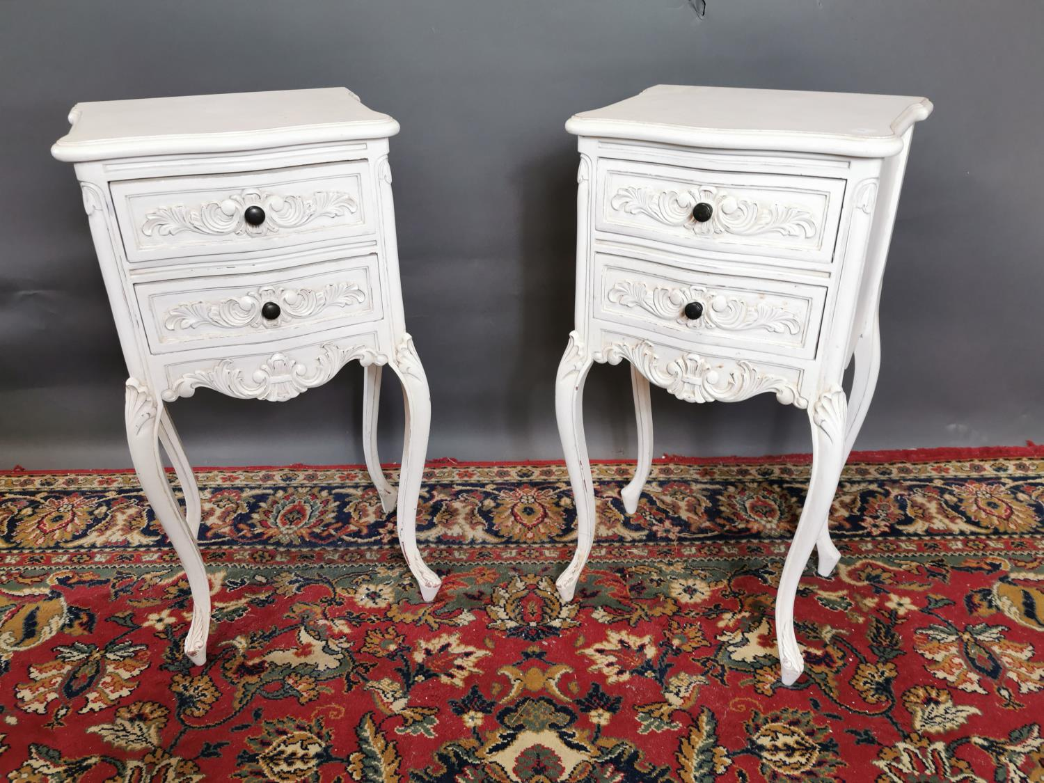 Pair of painted pine lockers in the French style with two drawers raised on cabriole legs. {74 cm H