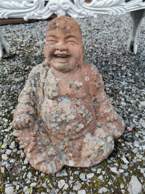 Teracotta Buddha statue.