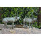 Pair of bronze models of piglets.