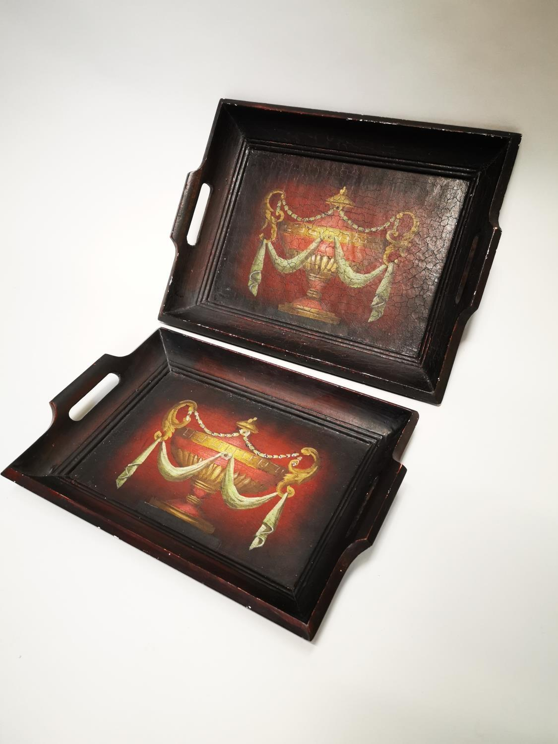 Two hand painted wooden serving trays