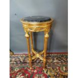 Carved giltwood lamp table