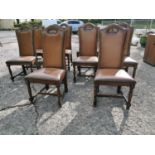 Set of ten leather upholstered oak dining room chairs