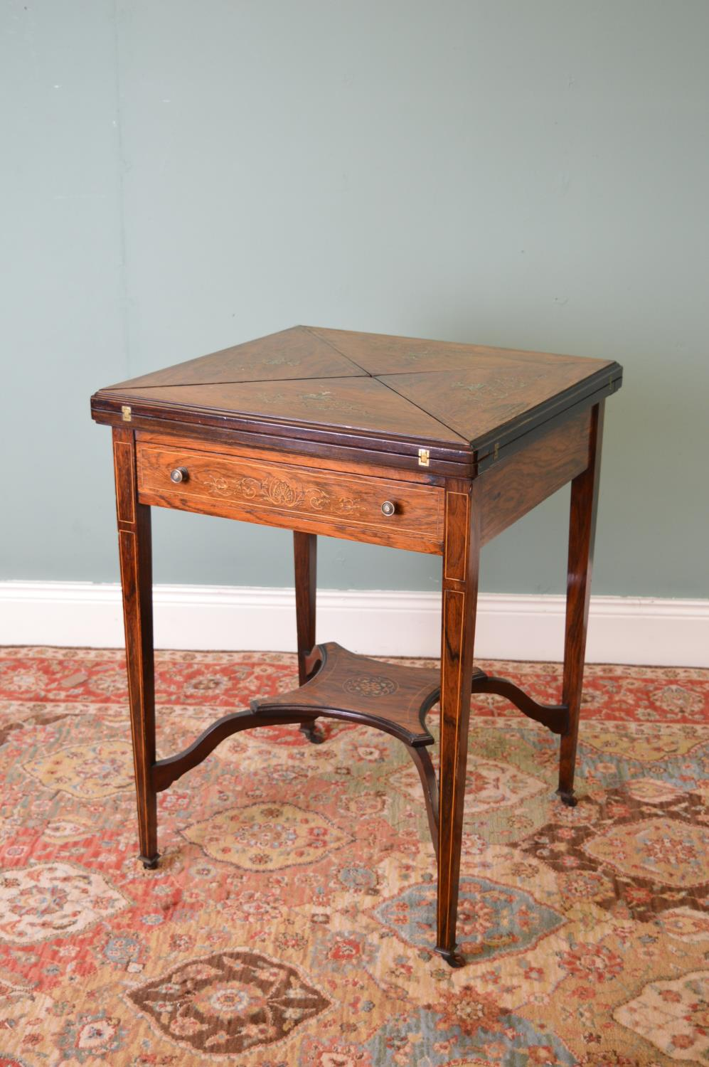 Edwardian rosewood and ivory inlaid envelope games table