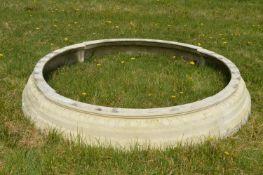 Composite resin and stone circular garden pond